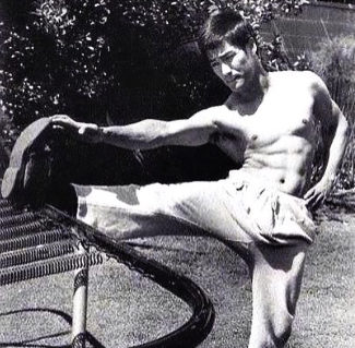 Bruce Lee stretching for flexibility before a workout